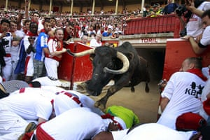 20 Photos: A fighting cow leaps over revellers into the bull ring in Pamplona