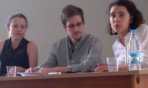 Edward Snowden gives a news conference at Sheremetyevo airport in Moscow with human rights activists