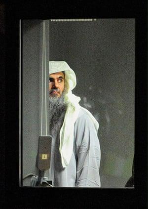 20 Photos: Radical cleric Abu Qatada prepares to board a plane at RAF Northolt