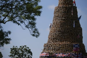 20 Photos: A man on a huge bonfire in the New Mossley area on the outskirts of Belfast