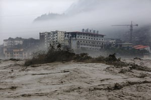 20 Photos: Heavy flood waters sweep through Beichuan in China's Sichuan province