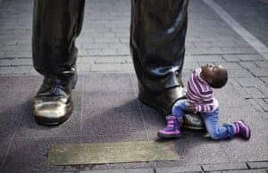 20 Photos: Three-year-old looks up at a sculpture of Nelson Mandela in Johannesburg