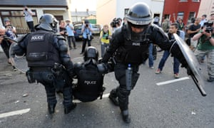A police officer is injured in north Belfast after an Orange parade was stopped from passing a Nationalist area.