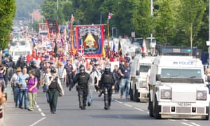 Orangemen move down Belfast's Crumlin Road earlier today