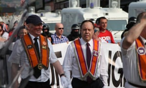 Democratic Unionst Party MP and Orangeman Nigel Dodds (right) marching today.