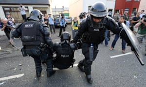 A police officer is injured during clashes in north after an Orange July 12 parade was stopped from passing a nationalist area.