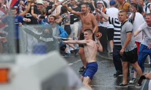 Loyalists confront police in north Belfast after an Orange Order parade was stopped from passing a Nationalist area.