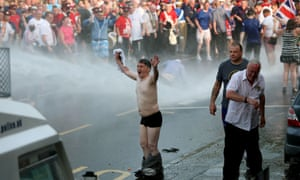 Loyalists confront police in north Belfast.