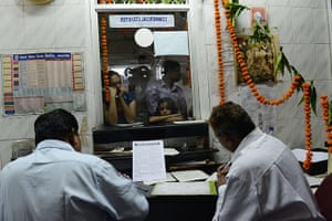 Indian telegraph closes: Customers wait at the counter at the Central Telegraph Office in Ahmedabad