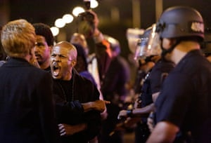 Zimmerman not guilty: A protester  shouts as  police try to remove protesters in Los Angeles