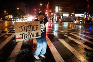 Zimmerman not guilty: A protester takes to the street in Harlem, New York
