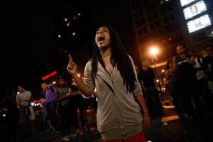 Zimmerman not guilty: A woman reacts to the news of Zimmerman verdict in New York