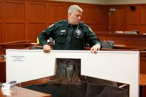 Zimmerman not guilty: A Sheriff's deputy carries Trayvon Martin's hooded sweatshirt