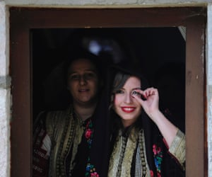 Bride Aleksandra Krstevska looks at her groom through a ring at a traditional wedding ceremony in the village of Galicnik, Macedonia. The Galicnik Wedding, a three-day traditional Macedonian wedding celebration held each 'Petrovden' or St. Peter's Day, involves traditional customs, costumes, and rituals and dances that have been passed down over the centuries