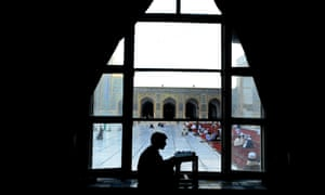 An Afghan man reads the Koran in a room at the main mosque during the month of Ramadan in Herat.