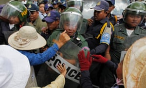 Cambodian police officers clash with residents of the squatter areas in Boeung Kak lakeside on a street during a protest in Phnom Penh, Cambodia.