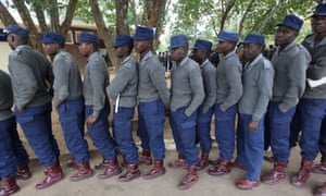 Police officers wait in a queue to cast their votes at a polling station in Harare, Zimbabwe.