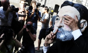 A demonstrator wearing a mask depicting Spanish Prime Minister Mariano Rajoy protests outside the Spanish National court in Madrid while People Party's former party treasurer appears in the court over a slush fund scandal. The disgraced former treasurer Luis Barcenas was called to appear in court after El Mundo published what it said was an original page from Barcenas' slush fund ledger and delivered the document to the court.