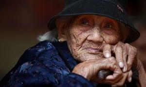 Liu Yuhua, a 104-year-old, rests at the Huangzhu village of Jinjiang township