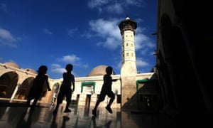 Children play outside Sayed al-Hashim Mosque during Ramadan in Gaza City.