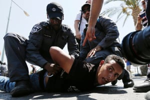 Policemen detain a protester during a demonstration in the southern Israeli city of Beersheba, Israel. Protesters scuffled with police during the demonstration against an Israeli cabinet plan to relocate some 30,000 Bedouin citizens from the southern Negev.