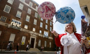 Royal supporter Margaret Tyler displays balloons in front of the Lindo Wing at St Mary's Hospital in London. The Duchess of Cambridge is due to give birth to her first child at the hospital any day now.