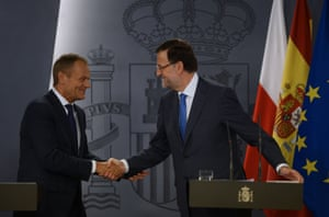 Spanish Prime Minister Mariano Rajoy (R) shakes hands with his Polish counterpart Donald Tusk (L) during a press conference after their meeting at the Moncloa palace in Madrid on July 15, 2013.