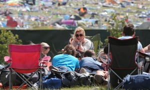 The morning after the weekend before. Festival goers wait to be picked up after leaving the 20th T in the Park music festival which was held at Kinross over the weekend.