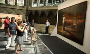 Portrait of Her Majesty Queen Elizabeth II by Ralph Heimans goes back on display in the Chapter House at Westminster Abbey in London, England. An enlarged security barrier and a guard are now in place after the painting was vandalised last month.