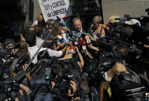 """A banner reading """"Law and control to clean up"""", is seen, as Miguel Bernard, General Secretary of Clean Hands, plaintiff in the case, talks to the media while the former People's Party treasurer, Luis Barcenas appears at the High Court in Madrid, Spain, Monday, July 15, 2013"""