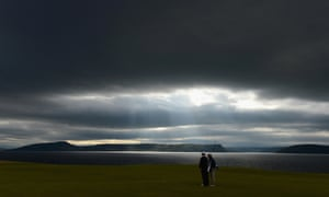 As the sun fights to get through, Chris Doak of Scotland waits on the 18th green during the final round of the Scottish Open in Inverness, Scotland.