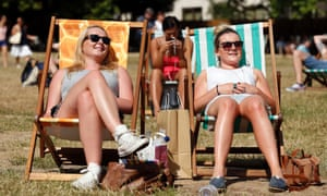 Park life: Visitors to Green Park enjoy the heatwave in London, England.
