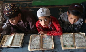 Boys read the Koran in a madrasa, or religious school, during the Muslim holy month of Ramadan in Kabul, Afghanistan.