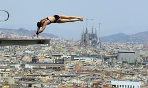 A diver trains at Montjuic local swimming pool in Barcelona, Spain ahead of the Barcelona 2013 World Swimming Championships that begin on 19 July.