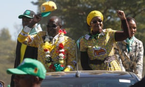 Zimbabwean President Robert Mugabe and his wife Grace greet party supporters during a campaign rally in Marondera. Zimbabwe is set to hold Presidential elections on 31 July.