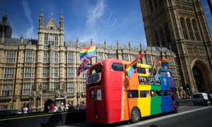 Love equality: Gay campaigners drive a bus past the Houses of Parliament as the Marriage (Same Sex Couples) Bill gets an unopposed third reading by the Lords in central London. Gay marriage was set to be legalised in England and Wales after the controversial Bill introducing it cleared the Lords today. Photograph: Andrew Cowie/AFP/Getty Images