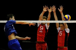 Aaron Koubi (L) of France hits a shot as Jelle Decoene (#5) and Lowie Stuer (#9) Timothee Carle of Belgium jump to block it during the boys Volleyball match between France and Belgium on Day 1 of the European Youth Olympic Festival held at Jaarbeurs in Utrecht, Netherlands.