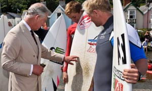 Prince Charles meets surfers in Cornwall on the day his secretary was defending his tax affairs