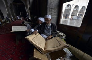 Yemeni men read the Koran on the fasting month of Ramadan at a mosque in Sana a. Ramadan is the ninth month of the Islamic calendar, a month of fasting, in which participating Muslims refrain from eating, drinking and sexual activities from dawn until sunset. Photograph: Yahya Arhab/EPA