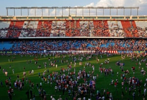 Fans invade the pitch after David Villa's presentation as a new Atletico de Madrid player at Estadio Vicente Calderon in Madrid, Spain. Photograph: Gonzalo Arroyo Moreno/Getty Images