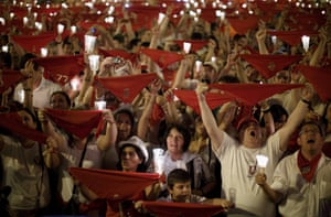 Revellers raise their scarves and candles as they sing the 'Pobre de Mi' song, marking the end of the San Fermin festival in Pamplona, Spain. Photograph: Pablo Blazquez Dominguez/Getty Images