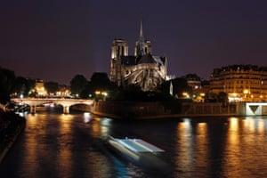 A tourist boat travels along the River Seine, near the Notre-Dame de Paris cathedral in Paris, France. Photograph: Benoit Tessier/Reuters