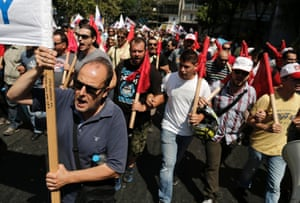 Supporters of the Communist-affiliated trade union PAME take part in an anti-austerity rally in Athens, July, 16, 2013, during a 24-hour general strike.