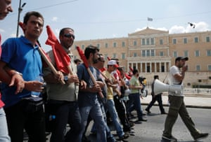 Supporters of the Communist-affiliated trade union PAME take part in an anti-austerity rally in front of the parliament in Athens July, 16, 2013, during a 24-hour general strike