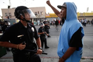 Trayvon protests: Los Angeles: A protester confronts a police officer