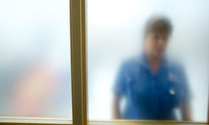 Nurse behind frosted glass