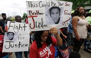 Trayvon protests: Birmingham, Alabama: Demonstrators march along  singing civil rights hymns
