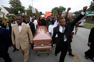 Trayvon protests: Houston: People participate in a demonstration led by activist Quanell X, r