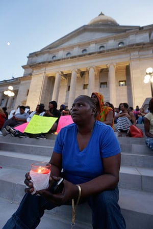 Trayvon protests: Little Rock: A woman holds a candle at a vigil on the steps of the Arkansas