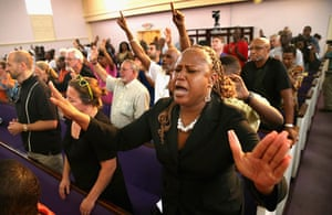 Trayvon protests: Sanford, Florida: Residents attend a prayer vigil to promote peace and unit